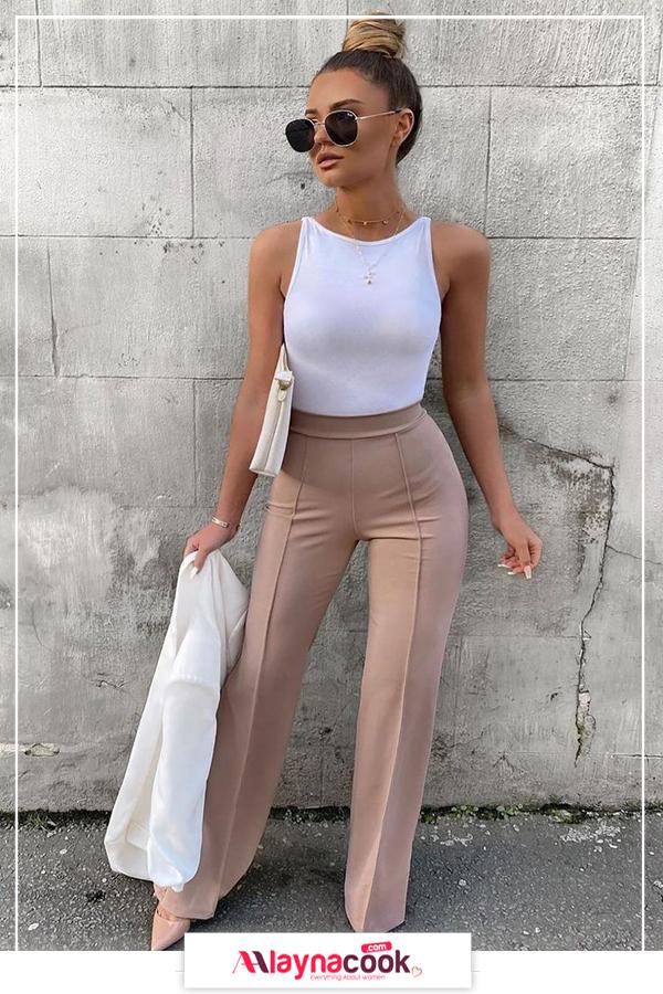 cream pants white sleeveless bodysuit stiletto and sunglasses