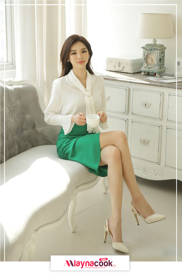 white skirt and green shirt cream high heels